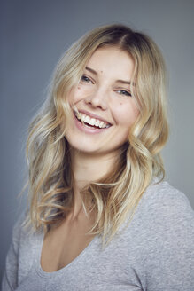 Portrait of laughing blond woman with moles - PNEF00521