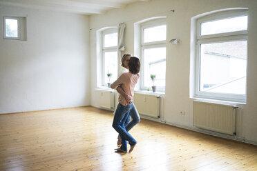 Mature couple dancing in empty room - MOEF00770