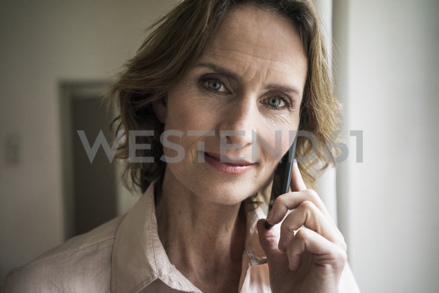 Portrait of smiling mature woman on cell phone - MOEF00791