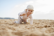 Spain, Lanzarote, baby girl crawling on the beach - DIGF03283