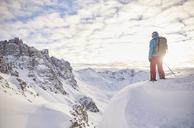 Austria, Tyrol, Kalkkoegel, Axamer Lizum, freeride skier looking into the valley at sunset - CVF00142