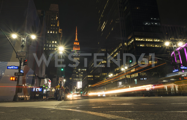 USA, New York City,  Eighth Avenue and Empire State Building at night - SEEF00011