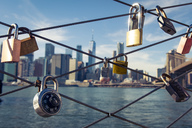USA, New York City, skyline and love padlocks as seen from Brooklyn Pier - SEE00035