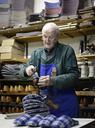 Senior shoemaker working on slippers in workshop - BFRF01819