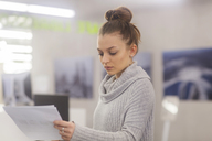 Portrait of young woman at work in an office - SGF02181