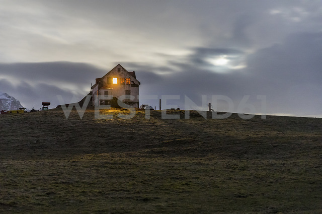 Iceland, Hofn, Illuminated window in a house in the countryside at night - WPEF00102
