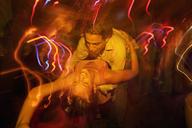 Couple dancing together in nightclub - FSIF00010