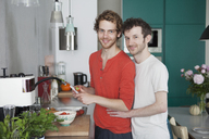 Portrait of loving gay couple in kitchen - FSIF00190