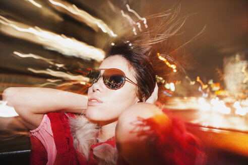 Glamorous woman in sunglasses enjoying car ride - FSIF00307