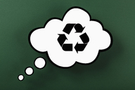 Recycling symbol in thought bubble against green background - FSIF00325