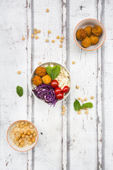Sweet potato balls, Couscous, Hummus and vegetables in bowls - LVF06689