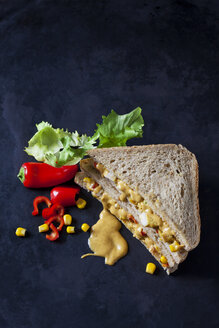 Chicken sandwich with corn, pepperoni and curry sauce on dark ground - CSF28895