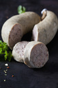 Sliced liver sausages, parsley and herbs on dark ground - CSF28904