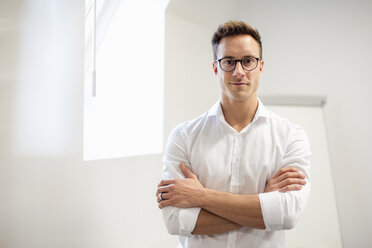 Portrait of confident young businessman in office - DIGF03299