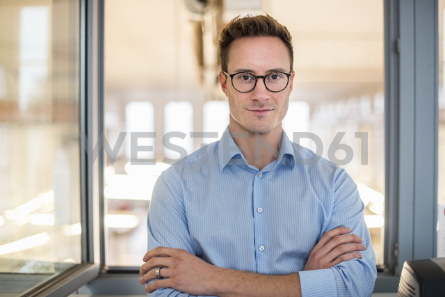 Portrait of confident young businessman in office - DIGF03320