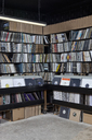 Rows of records on shelves and in bins at a record store - FSIF00367