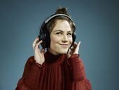 A young hip woman wearing headphones and smiling - FSIF00403