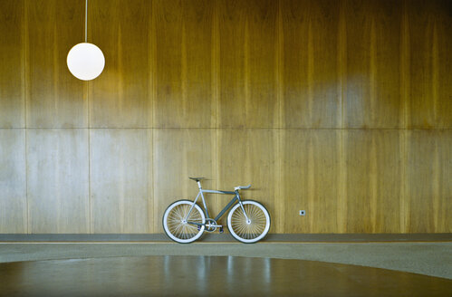 Bike parked against wood paneling - FSIF00466