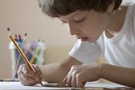 A boy drawing with a pencil - FSIF00472