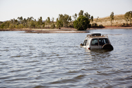 A 4x4 driving through deep water - FSIF00511