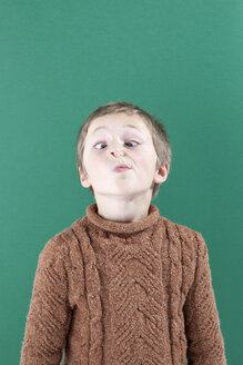 A young boy crossing his eyes looking at his nose - FSIF00535