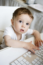 A toddler playing with a computer keyboard - FSIF00550