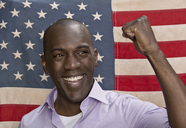 Man cheering in front of American flag - FSIF00664