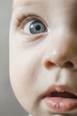A baby boy looking curiously into the camera, extreme close-up - FSIF00691