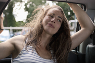Young woman sitting in car, Close-up - FSIF00709