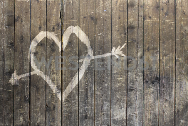 Heart shape with arrow symbol on wooden fence - FSIF00769