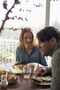 Couple having breakfast at dining table - FSIF00793