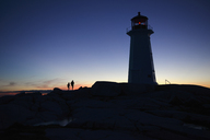 Silhouette lighthouse against clear blue sky - FSIF00814