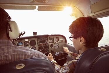 Father and son in cockpit of private airplane - FSIF01000