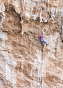 Greece, Kalymnos, woman climbing in rock wall - ALRF00903