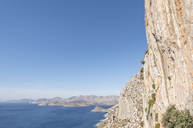 Greece, Kalymnos, climber in rock wall above the sea - ALRF00912