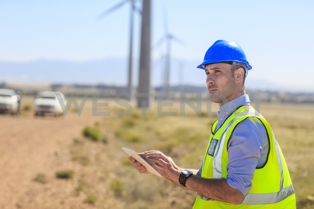 Engineer using tablet on a wind farm - ZEF14957