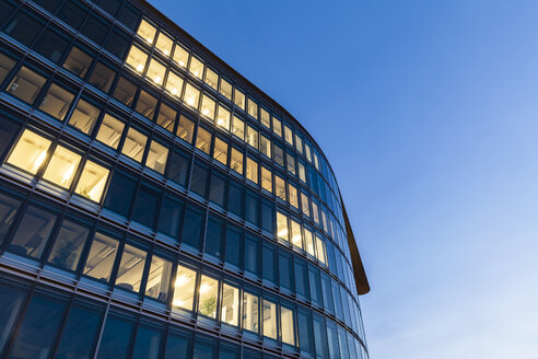 Germany, Baden-Wuerttemberg, office building at night - WDF04438