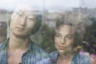 Close-up of couple seen through glass window - FSIF01031