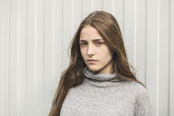 Portrait of teenage girl against white wall - FSIF01208