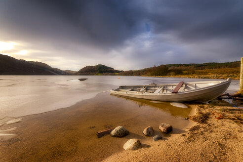 United Kingdom, Scotland, Highlands, Loch Ruthven, ice covered, fishing boat - SMAF00939