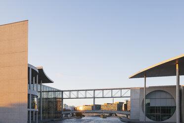 Germany, Berlin, Regierungsviertel, Paul-Loebe-Builing and Marie-Elisabeth-Lueders-Building at Spree river in sunset light - GWF05435