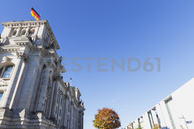 Germany, Berlin, Regierungsviertel, Reichstag building with German flags and Paul-Loebe-Building in autumn - GWF05438