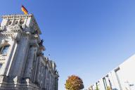 Germany, Berlin, Regierungsviertel, Reichstag building with German flags and Paul-Loebe-Building in autumn - GWF05438