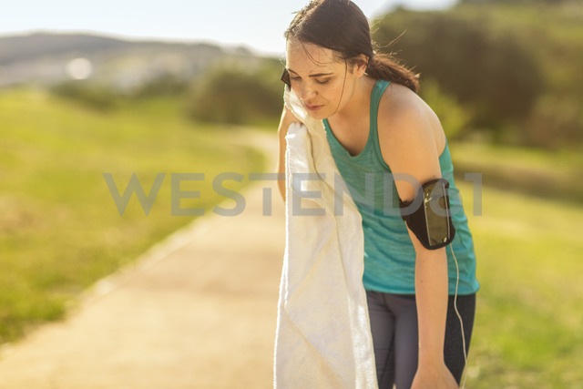 Exhausted female jogger having a break - ZEF15004