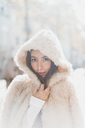 Portrait of young woman wearing hooded fur jacket - AFVF00018