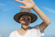 Portrait of woman wearing hat ageinst sky - AFVF00107
