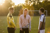 Young soccer players standing on field - FSIF01494