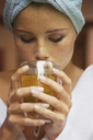 Close-up of woman drinking herbal tea at home - FSIF01581