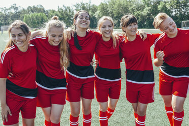 Cheerful soccer team standing on field - FSIF01749