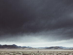 Scenic view of dramatic landscape against cloudy sky, Death Valley Road, California, USA - FSIF01815